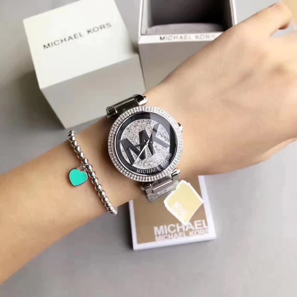 ffe55a03b180 Michael Kors Women s Parker Silver Watch MK5925. M 5b80909b4ab633dbe5f6534c